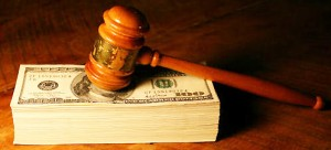 Judge Gavel on Stack of Money b